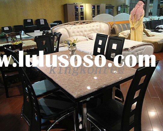 soild surface dining table with leather chairs
